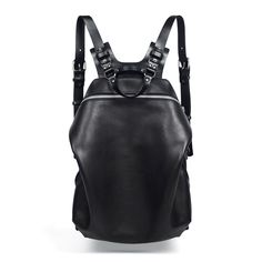Spiro Black Harness Backpack, zipped main closure. 1 outside zip pocket, 1 inside zip pocket. Adjustable shoulder straps. Hand or back. Handmade in France. All items on the TEO+NG site are made to order within 1-2 weeks,depending on the item. Color : Black Material : Cow leather, Veg