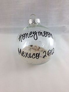 Take some sand from your wedding or honeymoon location to make your first Christmas ornament as a married couple. Cheesy but cute!