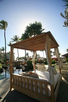 Lounge in a day bed by the pool. Kapalua Bay, Hotel Pool, Daybed, Outdoor Furniture, Outdoor Decor, Pools, Pergola, Lounge, Outdoor Structures