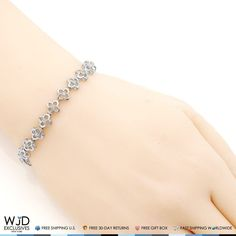 A unique take on the classic tennis bracelet, this diamond bracelet showcases round diamonds framed in a flower-inspired design of 925 sterling silver. Product Specifics   Metal 925 Sterling Silver   Style Flower Shaped Tennis Bracelet   Finish High Polished   Chain Type Tennis... #braceletdiamonds