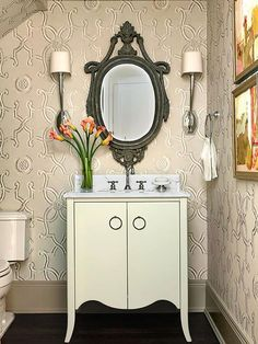 Subtly patterned wallpaper in a neutral shade adds warmth, character, and depth! http://www.bhg.com/bathroom/type/half/half-bath-design-ideas/?socsrc=bhgpin021015traditionalcharm&page=1