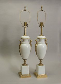 "Pair of white opaline glass and gilt bronze lamps.  French/Austrian. CIRCA: 1900's DIMENSIONS: 23.25"" h x 7"" w x 6.5"" d"