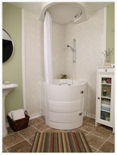 This soaking tub with shower is a walk-in bathtub designed for use by individuals with mobility or balance disabilities. And is lovely and practical for a small space.   Tiny Homes