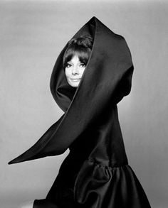 Audrey hepburn was also famous during that era. she is wearing a dress made by Valentino. this dress was designed during the 1960's. it is a little mix of the 50's and the 60's.
