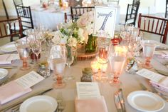 Table setting- love the pink goblets as water glasses! What a creative way to incorporate your wedding colors into all the details. #milestoneeventsgroup