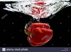 Download this stock image: Red pepper,  water splash. - KRTEKJ from Alamy's library of millions of high resolution stock photos, illustrations and vectors.