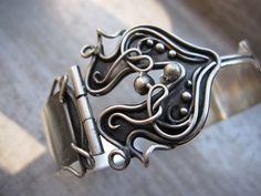 Amy Taylor - Silver cuff bracelet with hinged clasp