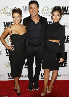 Lovely threesome: Lucky Mario Lopez was grinning like a Cheshire cat as he posed with his ...