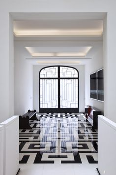 Arts and Crafts Entry and Hall in Paris, France by Pierre Yovanovitch Architecture d'Intérieur