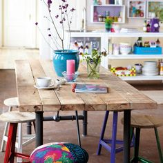 colorful stools, reclaimed wood table