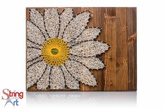 Daisy String Art.  This one of a kind and beautiful daisy string art kit is a perfect crafts project to create and hang in one day.  The kit comes with the highest quality embroidery floss, metallic wire nails, instructions, pattern template, and a HAND sanded and HAND stained wood board.  Visit www.StringoftheArt.com for more information!