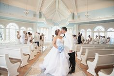 Guests wear all-white to a vow renewal wedding ceremony at Disney's Wedding Pavilion
