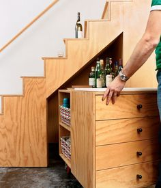 No room in the living room for a bar cart? Never fear! This ingenious little use of the space below the stairs invites you to store all your bar essentials simply and beautifully.