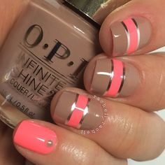 Pink and nude nails embellished with a nail striping tape.