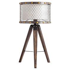 Cast a warm glow in your library or office with this industrial table lamp, featuring a tripod base and mesh shade.  Product: Ta...