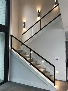 Steel and wooden staircases with a glass handrail lead to the second floor . - Steel and wooden stairs with a glass handrail lead to the second floor of this … – - Modern Stair Railing, Stair Railing Design, Home Stairs Design, Staircase Railings, Interior Stairs, Home Interior Design, House Design, Staircase Ideas, Railing Ideas
