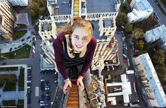 Skywalkers: Mr Oreshkin's photographs also show his friends posing hundreds of metres above the ground, including this unnamed girl