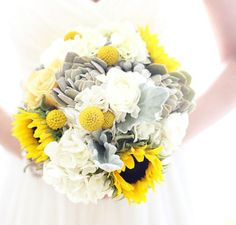 Yellow sunflowers, white and succulents bouquet