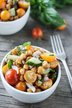 (Omit oil for Phase 1) Roasted Chickpea & Tomato Salad - Roasted chickpeas stand in for rustic bread in this gluten-free version of the classic Italian panzanella salad.