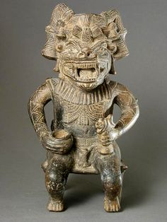 Tairona Vessel in the Form of a Masked Man Origin: Colombia Circa: 800 AD to 1200 AD