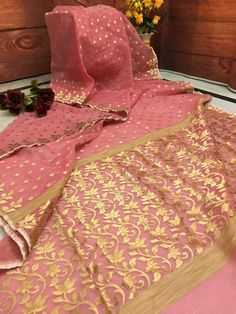 This brilliant Pink Color Resham Handloom saree gets an illusive appearance with the exquisite zari weaving. Enjoy the gorgeousness of the bright and beautiful saree along with the comfort of Handloom.