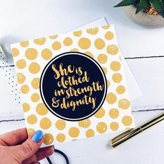 She Is Clothed In Strength & Dignity Gold Card - Proverbs Blessed Friends, Step Mum, Proverbs 31 25, She Is Clothed, Dog Cards, Black Tote Bag, Brush Lettering, Someone Elses, White Envelopes