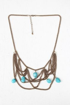 Antique Stones Tiered Statement Necklace - Bronze  Description Statement  necklace  featuring antique-finish curb link chains ...   https://nemb.ly/p/VyK5Z_Spg