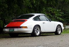 White 911 with Tangerine engine cover