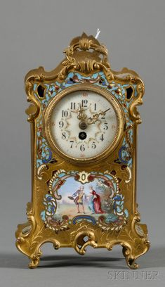 Champleve Enamel Timepiece, France, late century, gilt-bronze case polychrome enamel decorated, below the dial a cartouche with lovers. Large Vintage Wall Clocks, Antique Clocks, Large Clock, Tabletop Clocks, Mantel Clocks, Old Watches, Vintage Watches, Romanesque Art, French Clock