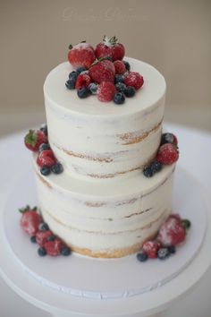 Semi-naked cake with frosted berries