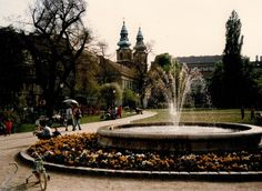 the garden of the Károlyi palace serves today as a public park. the towers of the University church are visible in the background