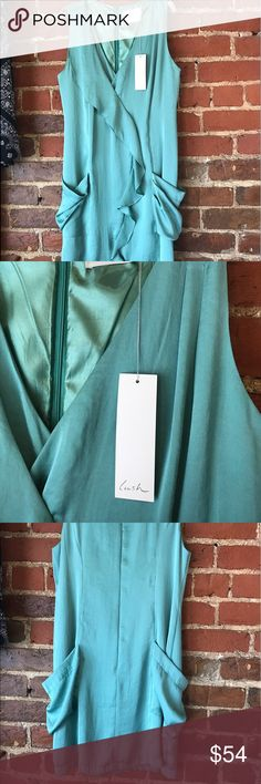 Lush mid-length dress, shimmery green, size Large NWT Lush lined mid-length dress in a shimmery green! Sleeveless, polyester/rayon blend. New Boutique Retail. Inventory item #272-11 Lush Dresses Midi