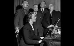 Always one to lead the boys, Thatcher plays the piano during a sing-along in this 1950s photo taken at the Bull Inn in Dartford.