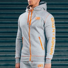 CozyFit Hoodies - Grey & OrangeSHIPPING: PROCESSING TIME 3 - 4 Days ESTIMATED DELIVERY TIME 3 - 4 days for Domestic 4 - 6 days for International Superior quality cotton fleece hoodie, soft, warm and snug tapered fit; your perfect winter companion. Designed with quality in mind, the same great feel after multiple washes, good as new for multiple winters to come. Styled for all day wear: complete with orange zip pockets, printed logos, contrast stitching & draw strings. 78% cotton / 22%…