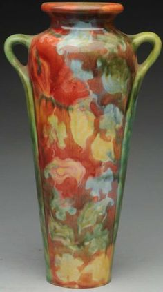 "Zsolnay 2-Handled Vase. 10"" T. With soft floral Impressionist decoration. Raised wafer mark on underside. 13/L1680U"