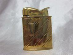 Evans 1950u0027s Gold Toned Finish With Diagonal And Vertical Lines Banner  Petrol Pocket Lighter