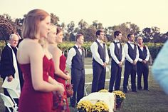 Groomsmen in grey vests