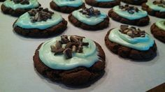 Grasshopper cookies Devil's Food cake mix, 2 eggs, 1/2 cup oil. Mix. Roll into balls, press somewhat flat onto parchment paper on a cookie sheet. Bake at 350 for 8 min. Let cookies cool. Mint frosting: approx. 3 cups powdered sugar, 1 1/2 tsp peppermint extract, 2 tbsp milk, 2 drops green food coloring. May need to adjust powdered sugar to make it think enough to frost with. Top cookies with crushed Andies mints