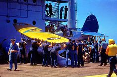 Crew removing a plane which has made a slight crash landing on the Enterprise CV-6 aircraft carrier during the US Navy's Pacific Fleet maneuvers, 1940.