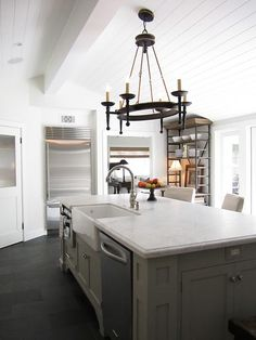 Here is the other side of that island. I love how it feels solid and substantial with lots of function on the kitchen side, and has plenty of leg room for the stools on the other.