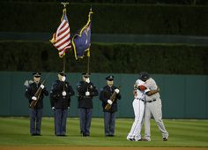Boston Red Sox's David Ortiz, right, hugs Detroit Tigers' Torii Hunter before the start of Game 4 of the American League baseball championsh...