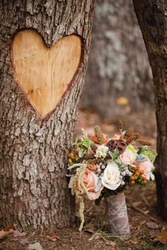 Autumn Wedding Ideas, Outdoor Wedding Idea use Seasonal or Themed Flowers. A great idea too is to take a long log and cut holes to place candles or flowers; use iron or other metal for legs-that cradle log. I will post it in here-or see my DIY decor or outdoor living spaces boards. Happy Planning & Nuptials!