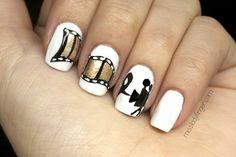 GET THE LOOK: Zooey Deschanel's Film Strip Nails Here it...