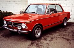 BMW 2002 series. In red. I want to eat this. What?
