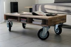 This funky wheeled coffee table can follow you around your living room and looks stylish too! Recycled pallet wood by YvaRDesigN on Etsy
