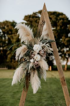Wooden Frame with Muted Flowers, Foliage and Dried Grasses Eco Friendly Wedding Inspiration at Wickerwood Farm with Woodland Boho Luxe Theme with Pampas Grass, Macrame, and Smoke Bombs by Elena Popa Photography Floral Wedding, Fall Wedding, Wedding Bouquets, Rustic Wedding, Wedding Flowers, Dream Wedding, Wedding Blog, Wedding Ideas, Dried Flower Arrangements