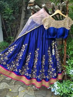 Blue raw silk lehenga with heavy work  Price-15000