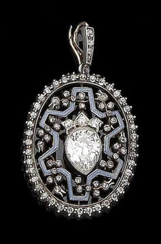 An enamel and diamond pendant, circa 1900 The oval finely pierced plaque set with single and rose-cut diamonds and decorated with light blue enamel, suspending a pear-shaped diamond swing centre, principal diamond approx. 1.20cts, later swing centre, length 3.8cm