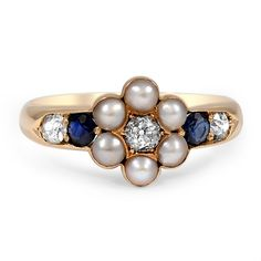 The Rana Ring.  Gorgeous cultured pearl petals surround a sparkling old mine cut center diamond in this nature-inspired Victorian-era ring from the 1890's.