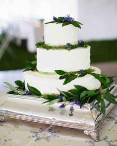 40 Fresh Floral Wedding Cakes | Martha Stewart Weddings - Mary Carmel Wetherby of The Sugar Woods baked this tiered vanilla-almond confection and covered it with buttercream frosting, fresh herbs, and flowers.